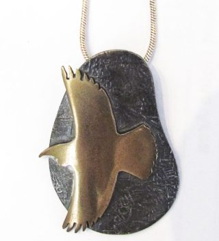 Sterling Silver and Bronze Tui Pendant